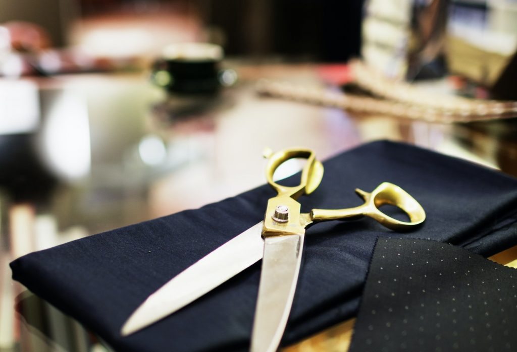 Scissors on fabric in clothing store